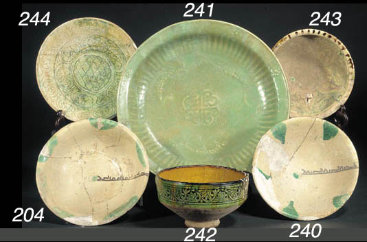 A Nishapur green pottery bowl