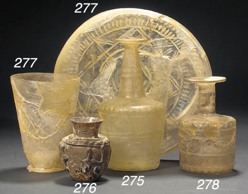 A Nishapur clear glass cylindr