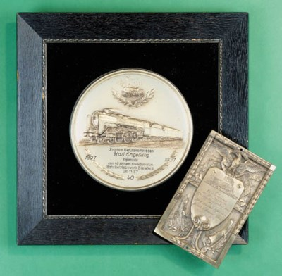 A silvered metal commemorative