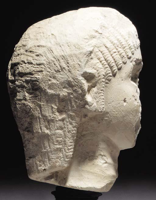A LIMESTONE HEAD OF A NOBLEWOM