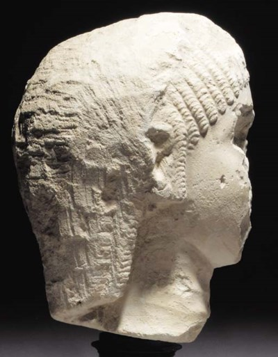 A LIMESTONE HEAD OF A NOBLEWOM