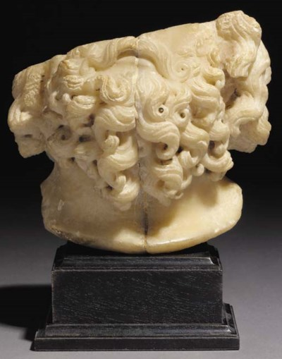 AN ALABASTER LOWER HALF OF A F