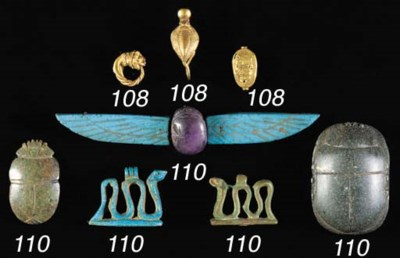 AN EGYPTIAN AMETHYST SCARAB AT