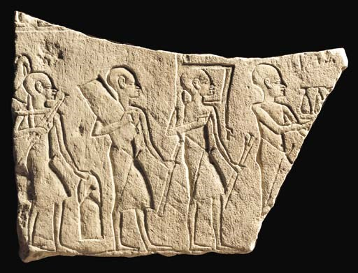 AN EGYPTIAN LIMESTONE RELIEF
