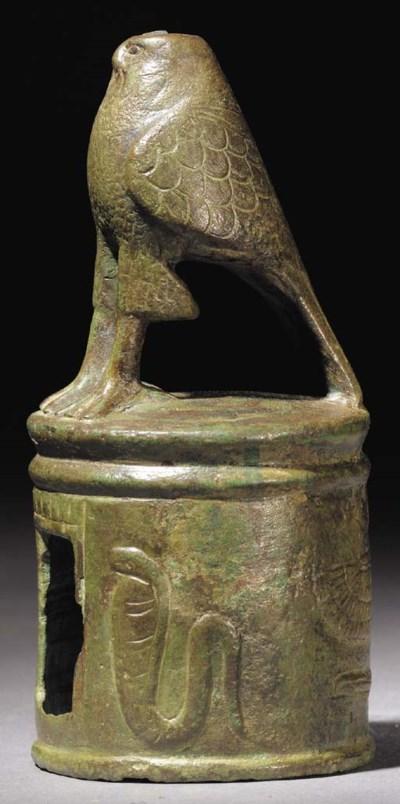 AN EGYPTIAN BRONZE HORUS SHRIN