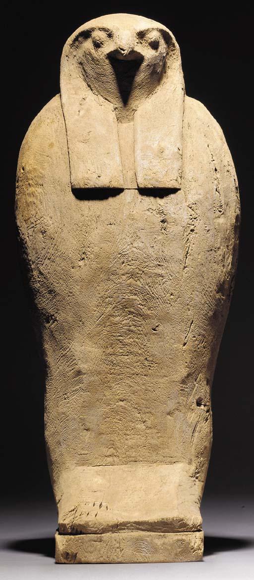 AN EGYPTIAN HOLLOW WOODEN FALC