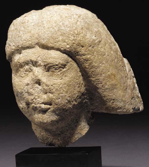AN EGYPTIAN LIMESTONE FEMALE H