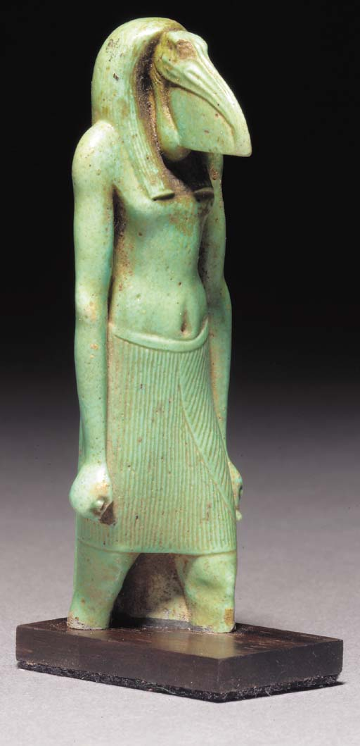 AN EGYPTIAN GREEN GLAZED COMPO