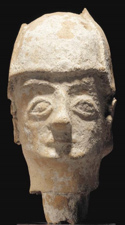 A CYPRIOT TERRACOTTA HEAD OF A