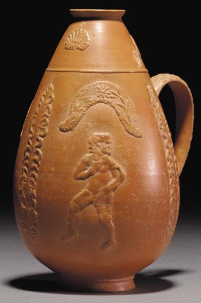 A ROMAN RED-SLIP WARE FLASK
