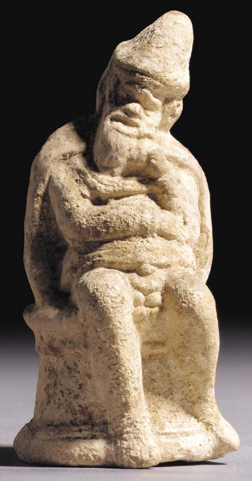 AN ATTIC TERRACOTTA FIGURE OF