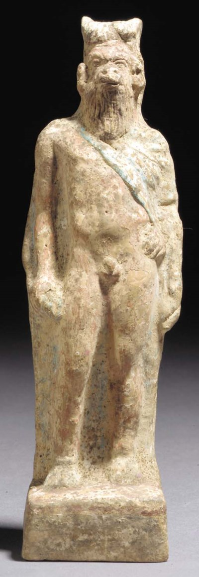 A GREEK PAINTED TERRACOTTA FIG