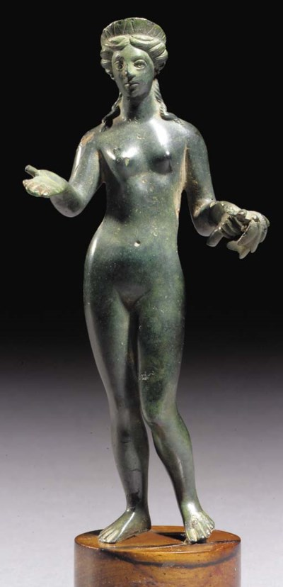 A ROMAN BRONZE FIGURE OF APHRO