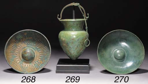 A GREEK BEATEN BRONZE SITULA