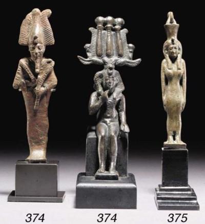 AN EGYPTIAN BRONZE FIGURE OF T