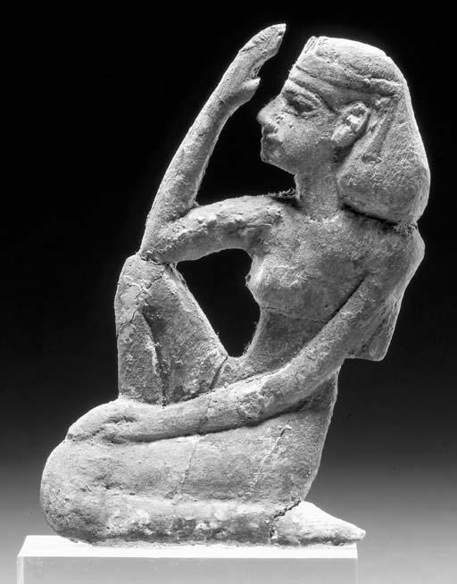 AN EGYPTIAN BRONZE FIGURE OF I