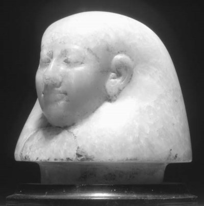 AN EGYPTIAN ALABASTER HEAD FRO