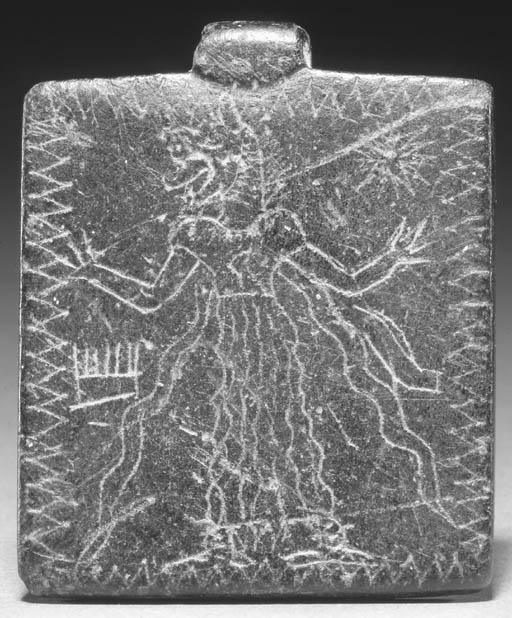 A MESOPOTAMIAN BLACK STONE LAM