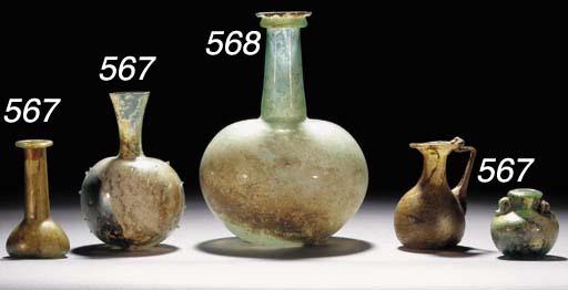 A ROMAN GREEN GLASS PINCHED FL