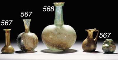 A ROMAN GREEN GLASS PINCHED FL