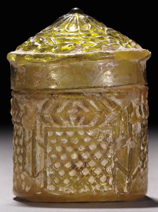A ROMAN MOULD-BLOWN GREEN GLAS