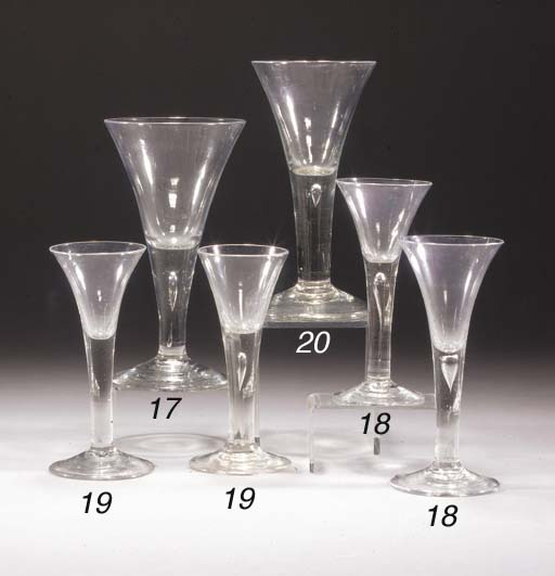 Six plain-stemmed wine glasses