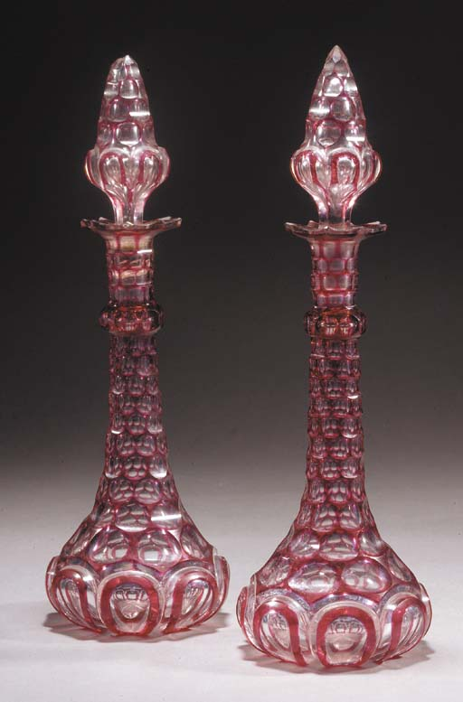 A pair of ruby overlay scent f