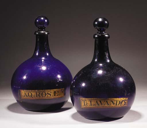Two amethyst pharmacy bottles
