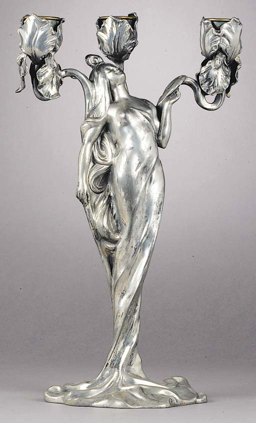 A silvered pewter and brass candelabrum