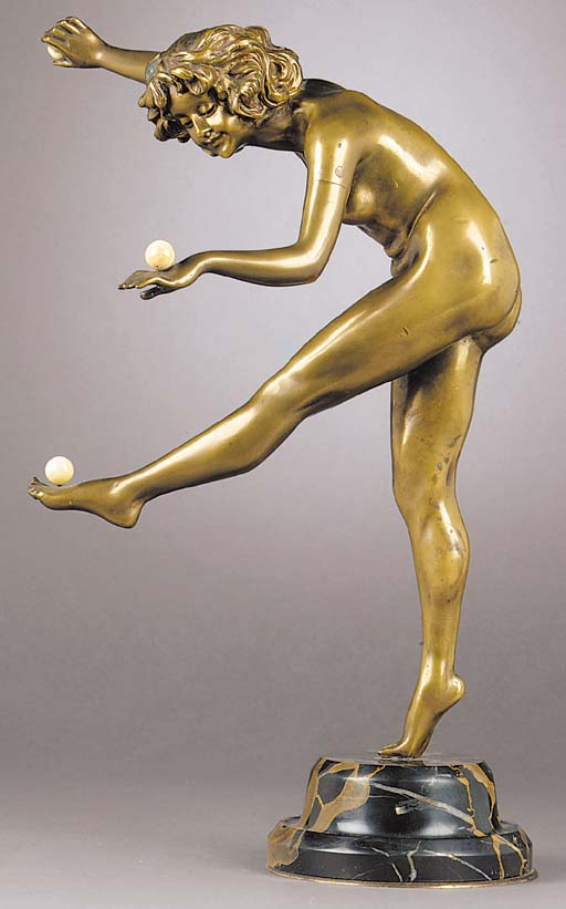 A patinated bronze and ivory figure