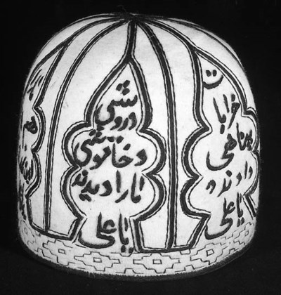 A conical white felt hat,