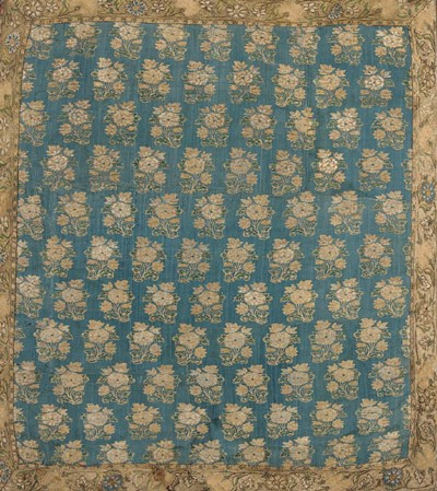 A panel of blue silk brocade,