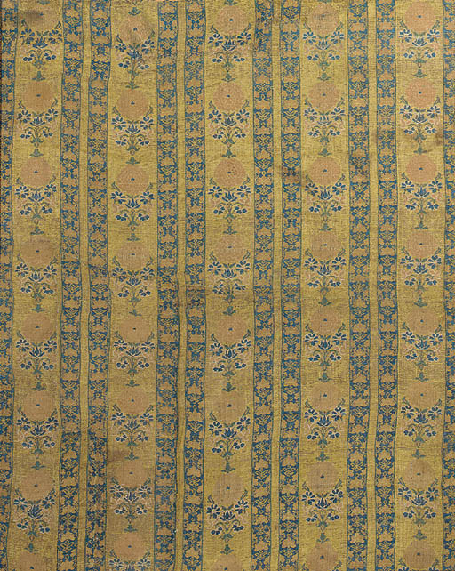 A panel of gilt ground brocade