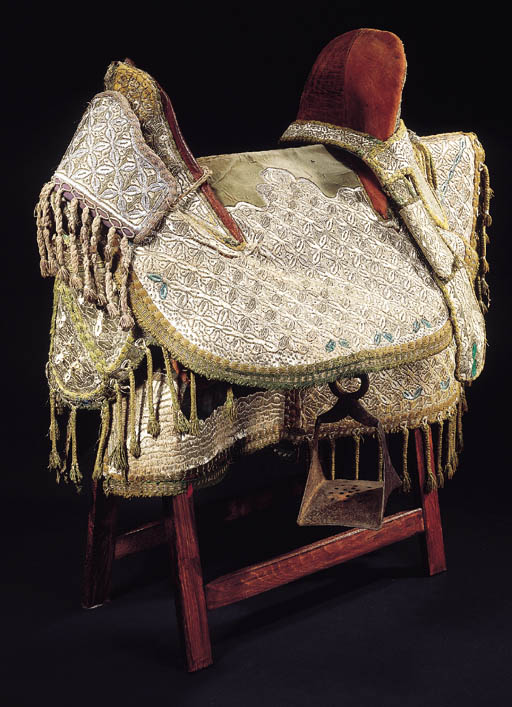 A leather saddle and embroider