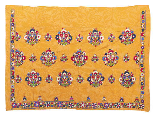 An embroidered cover of yellow cotton damask,