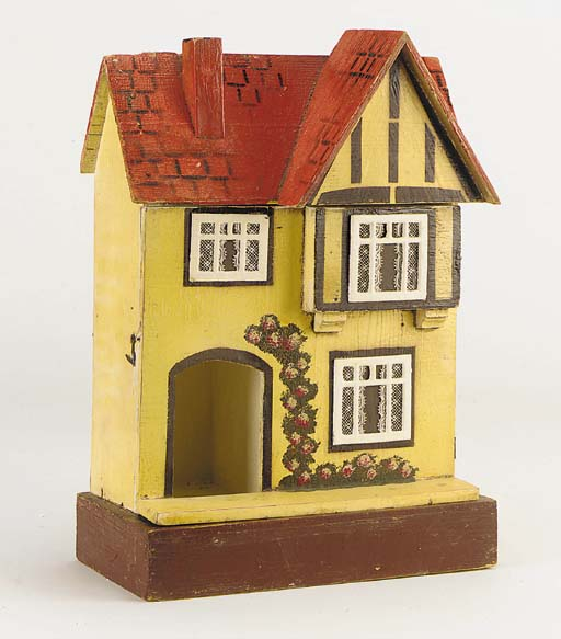 A small red roof dolls' house