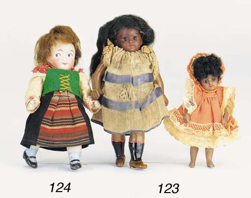 A brown bisque-headed dolls' h