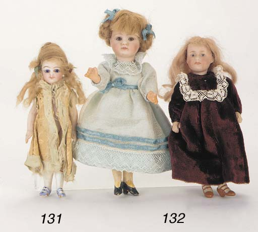 A bisque-headed character doll