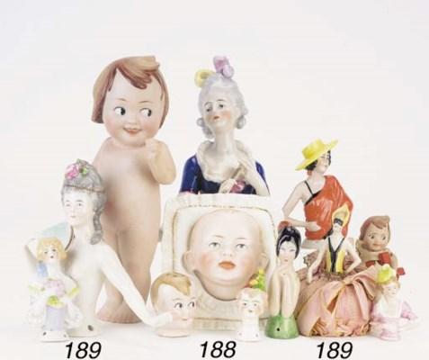 A Goebel china half-doll