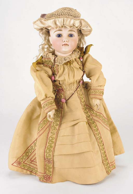 A child doll with closed mouth