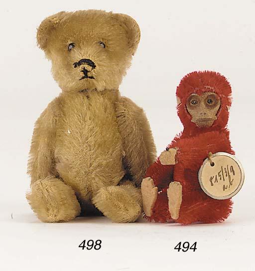 A Schuco teddy bear perfume bo