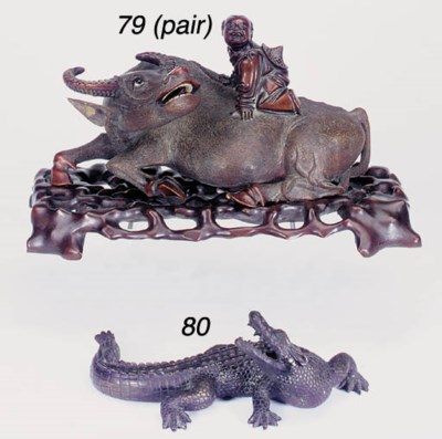 A copper alloy model of a croc