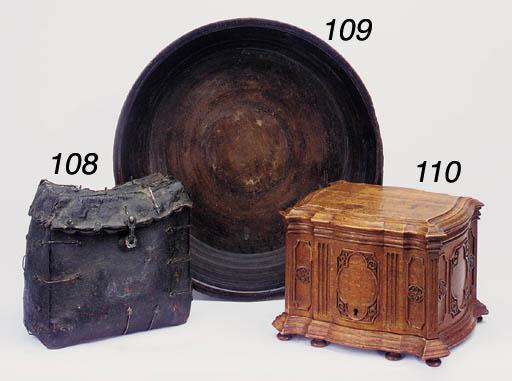 A Continental carved oak cigar