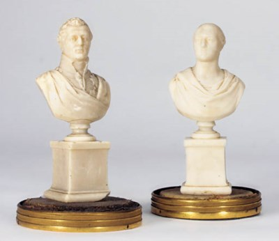 A pair of George IV sculpted w