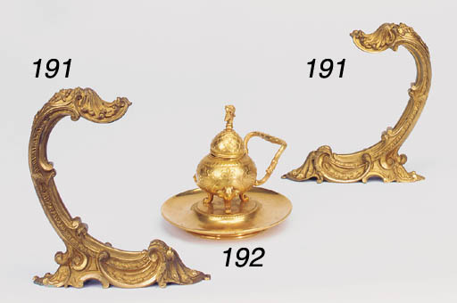 A set of six gilt bronze curta