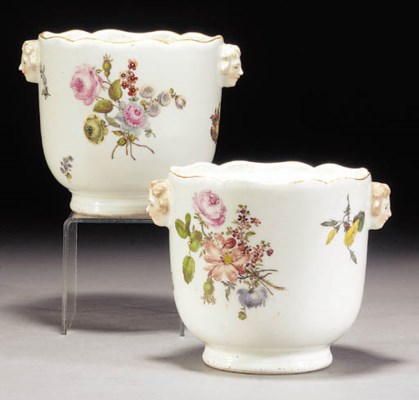 A pair of Meissen câche pots