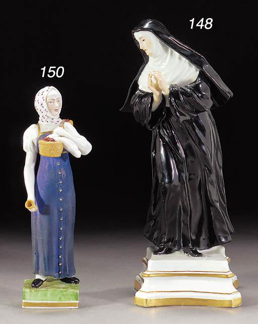 A Meissen figure of a nun