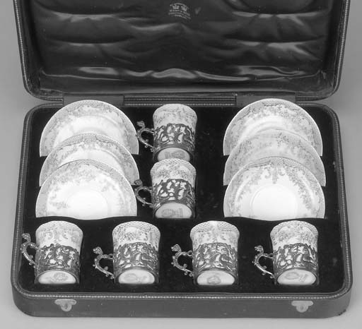 A CASED SET OF SILVER AND PORC