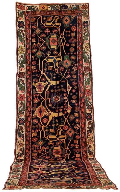 An antique Bijar narrow kelleh