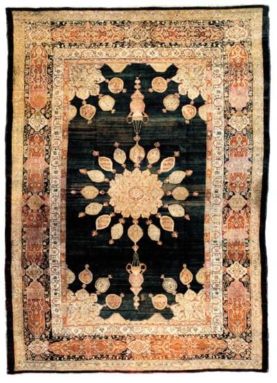 An fine antique Agra carpet, N